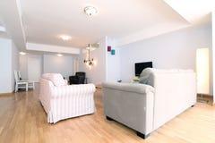 Livingroom med nytt möblemang Fotografering för Bildbyråer