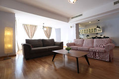 Livingroom with new furniture. Big living room with modern couches royalty free stock photography
