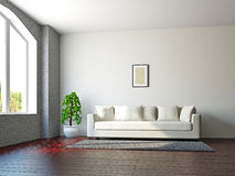 Livingroom with sofa and a plant Stock Photo