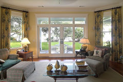 Livingroom with waterfront view stock photography