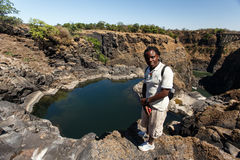 LIVINGSTONE - OCTOBER 01 2013: Guide shows the landscapes of the Royalty Free Stock Photography