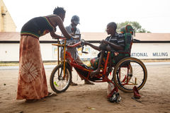 LIVINGSTONE - OCTOBER 14 2013: Local disabled man with an adapted wheelchair sets up successful shoe repair business in. Livingstone, Zambia, Africa stock photography