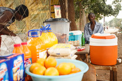 LIVINGSTONE - OCTOBER 14 2013: Local man sells oranges and refre Royalty Free Stock Photos