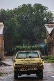 An old Toyota car on Livingstone Street under heavy rainfall in the rainy season stock images