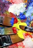 Livliga slaglängder och målarpenslar Royaltyfri Fotografi