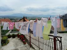 Livno / Bosnia and Herzegovina - June 28 2017: Laundry is drying on a rope near a house. Panorama of Livno is on the background royalty free stock photo