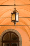 Livorno. Old iron lantern in an arcade royalty free stock photo