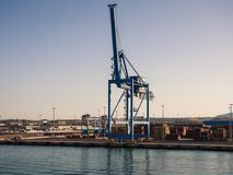 Shipping industrial trade port. Crane bridge and import export c Stock Images