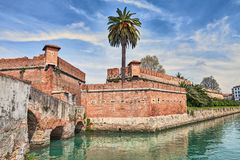 Livorno - Leghorn, Tuscany, Italy: the fortress Fortezza Nuova. Livorno - Leghorn, Tuscany, Italy: the old fortress Fortezza Nuova surrounded by a navigable moat Royalty Free Stock Image
