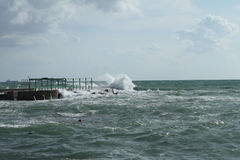 Livorno, rough seas. Windy and cloudy day with high waves near the pier Stock Photography