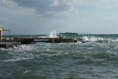 Livorno, rough seas. Windy and cloudy day with high waves near the pier Royalty Free Stock Image