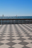 Livorno` s Mascagni Terrace and White Sailing Boats in Backgroun Stock Images