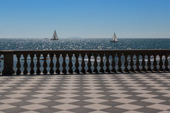 Livorno& x27; s Mascagni Terrace and White Sailing Boats in Backgroun Royalty Free Stock Photo