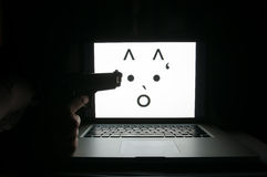 Livrädd framsida på den hotade datoren Fotografering för Bildbyråer