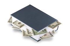 Livre avec des dollars Photo stock