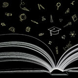 Livre avec des icônes d'éducation Photographie stock