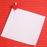 Livre blanc avec le clip de forme de coeur Images stock