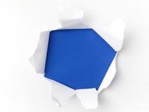 Livre blanc déchiré sur le fond bleu Cocept pour le jour de conscience d'autisme Barrières de coupure ensemble pour l'autisme Image libre de droits