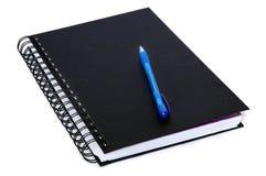 Livre d'écriture et crayon lecteur bleu photographie stock