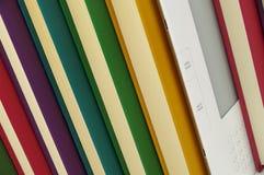 Livre d'E et livres de relevé colorés Images stock