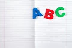 Livre d'exercice et lettres rayés d'ABC photographie stock