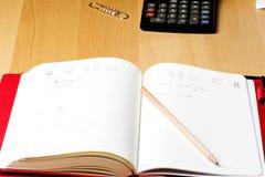 Livre de calendrier de rappel d'affaires de planificateur Image libre de droits