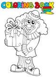 Livre de coloration avec le clown et le cadeau Photos stock