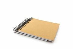 Livre de croquis sur le fond blanc Photos stock