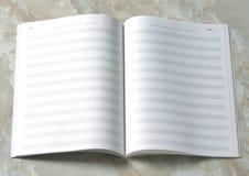Livre de notation musicale photographie stock