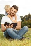 Livre de relevé de père et de fils Photos libres de droits