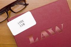 Livre des lois légalement le Droit Civil avec la carte de visite professionnelle de visite photo libre de droits