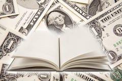 Livre et argent comptant Image libre de droits