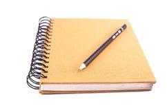 Livre et crayon Photographie stock libre de droits
