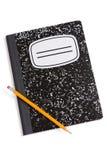 Livre et crayon de composition Images stock