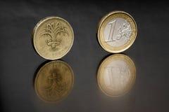 Livre et euro Photos stock
