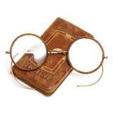 Livre et lunettes antiques Photos libres de droits