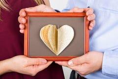 Livre fait main d'amour sur le cadre de tableau Photos stock