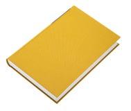 Livre jaune d'isolement sur le blanc Images libres de droits