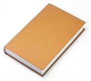 Livre orange d'isolement sur le blanc. Nettoyez le cache photos stock