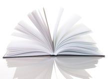 Livre ouvert rempli par lumière magique Photos stock