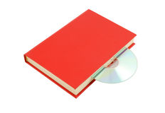 Livre rouge avec du Cd d'isolement Photo stock