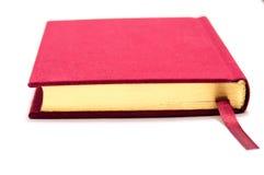 Livre rouge d'isolement Photo stock