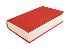 Livre rouge d'isolement sur un fond blanc Photographie stock libre de droits