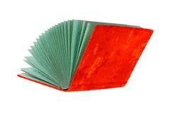 Livre rouge ouvert lumineux d'isolement sur le fond blanc Images stock