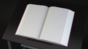 Livre sur la table Photos stock