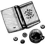 Livre, thé et bonbons Images stock