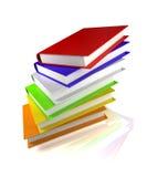 Livres colorés sur le blanc lustré Photo stock