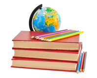 Livres, crayons et globe Image stock