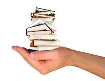 Livres dans la main Images libres de droits