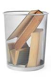 Livres dans la poubelle Photographie stock libre de droits